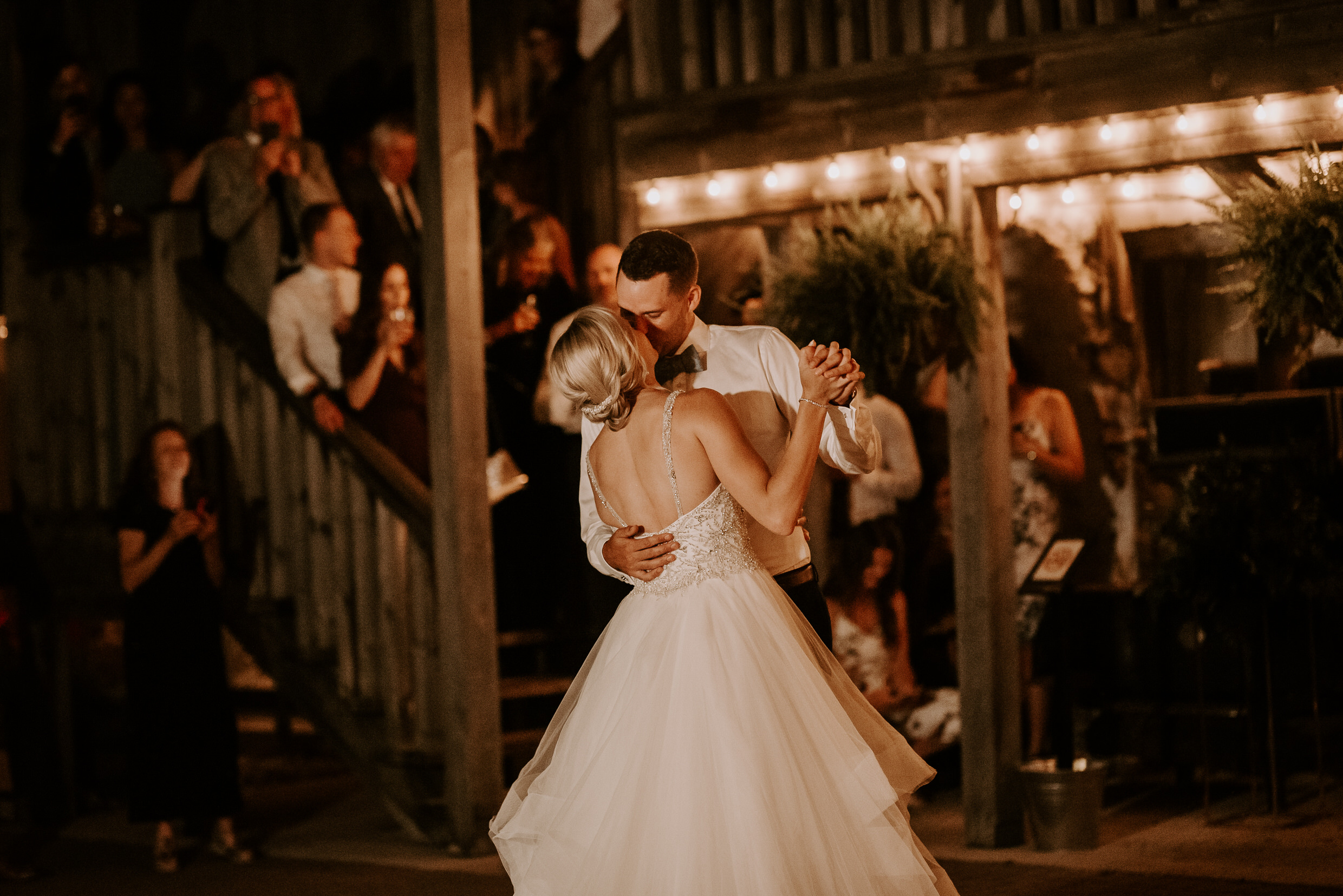 Belcroft Estates Wedding - bride and groom kiss and dance