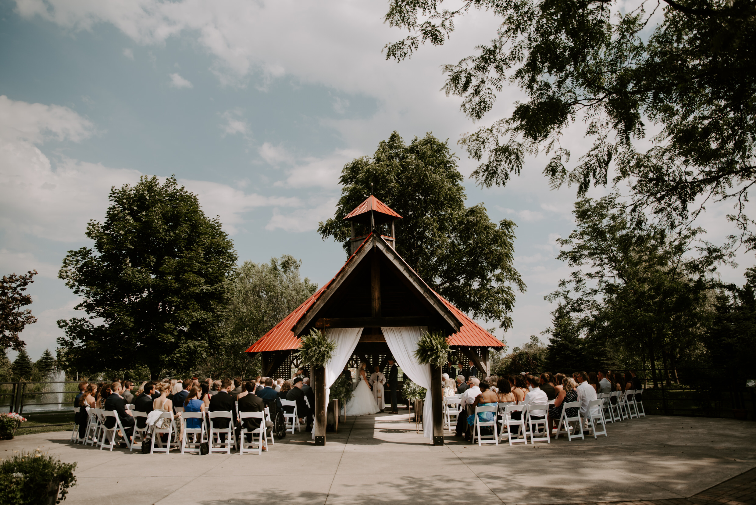 Belcroft Estates Wedding - wedding ceremony under gazebo