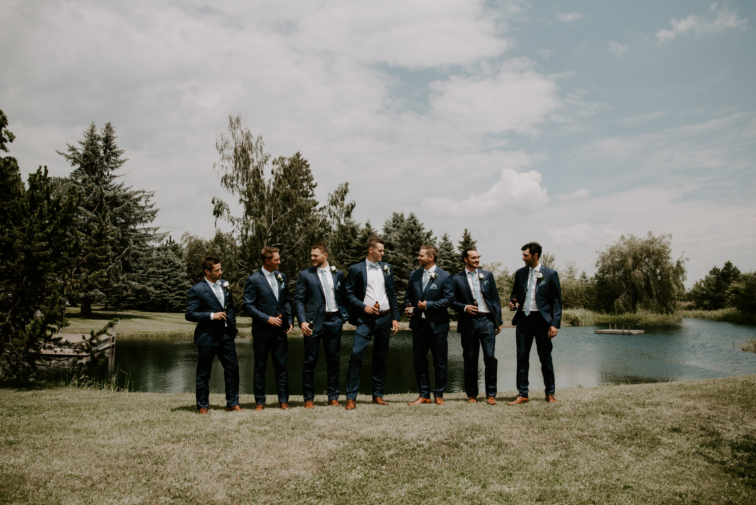 Belcroft Estates Wedding- groomsmen by the pond
