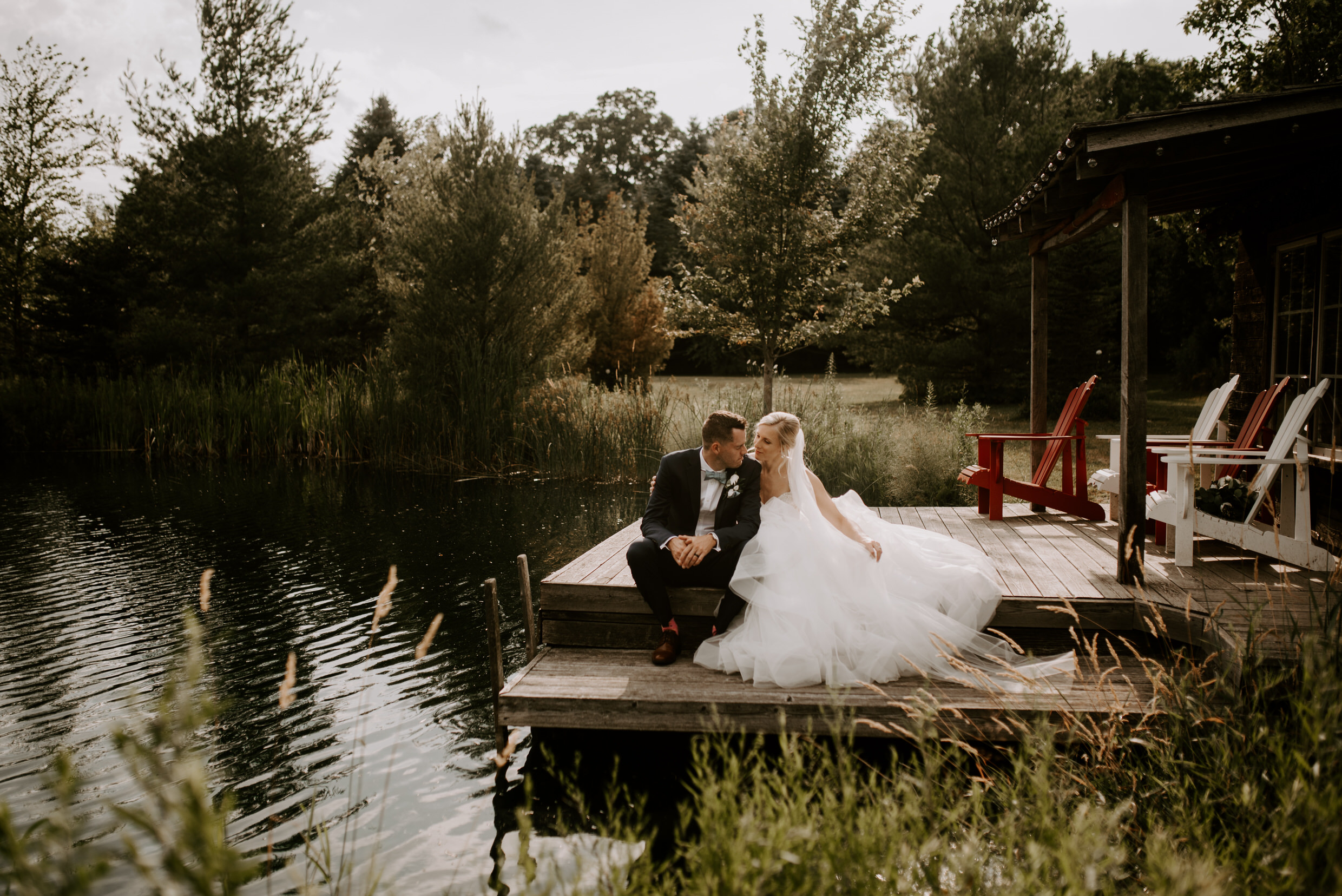 Belcroft Estates Wedding - bride and groom on the dock