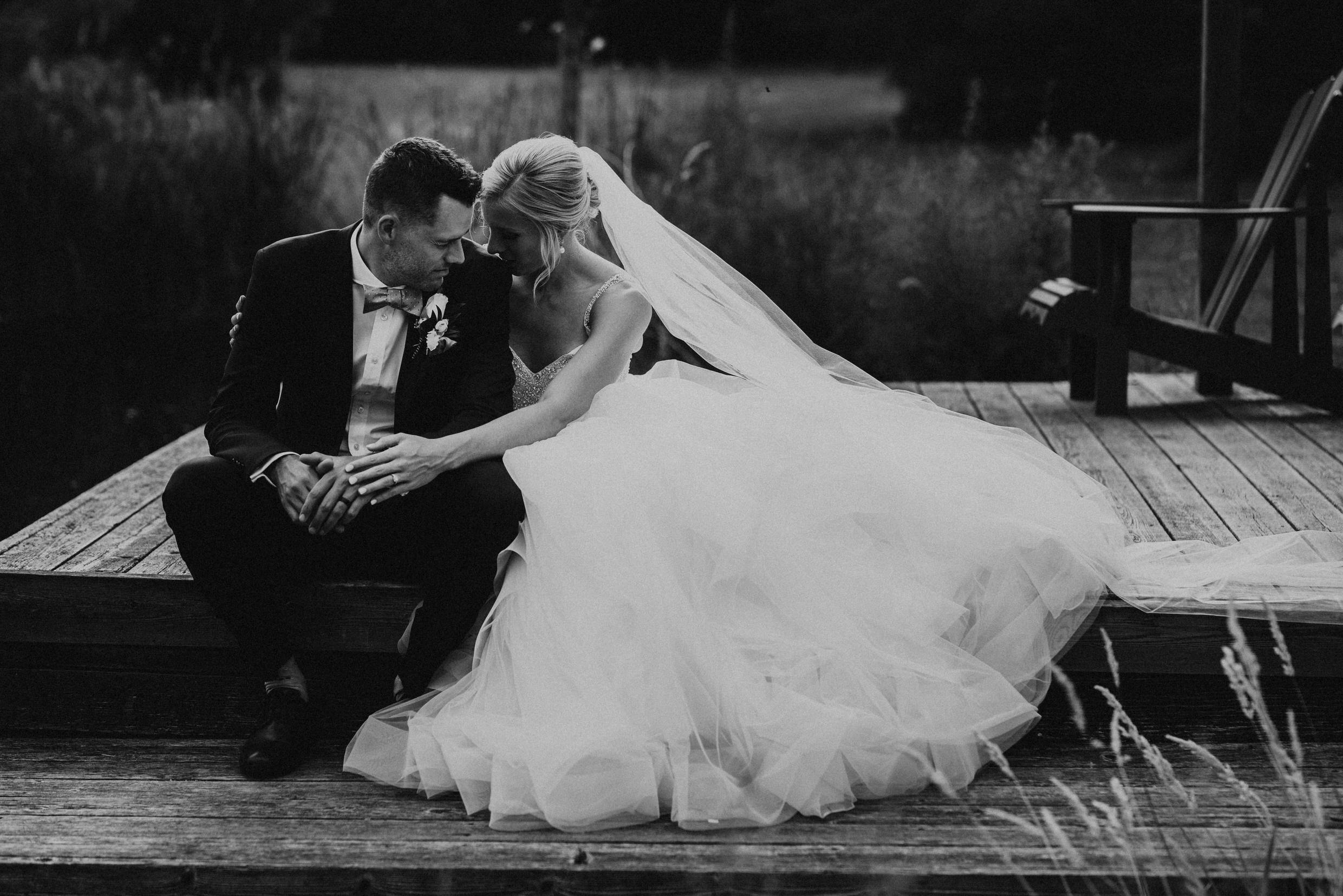 Belcroft Estates Wedding - bride and groom embrace on the dock