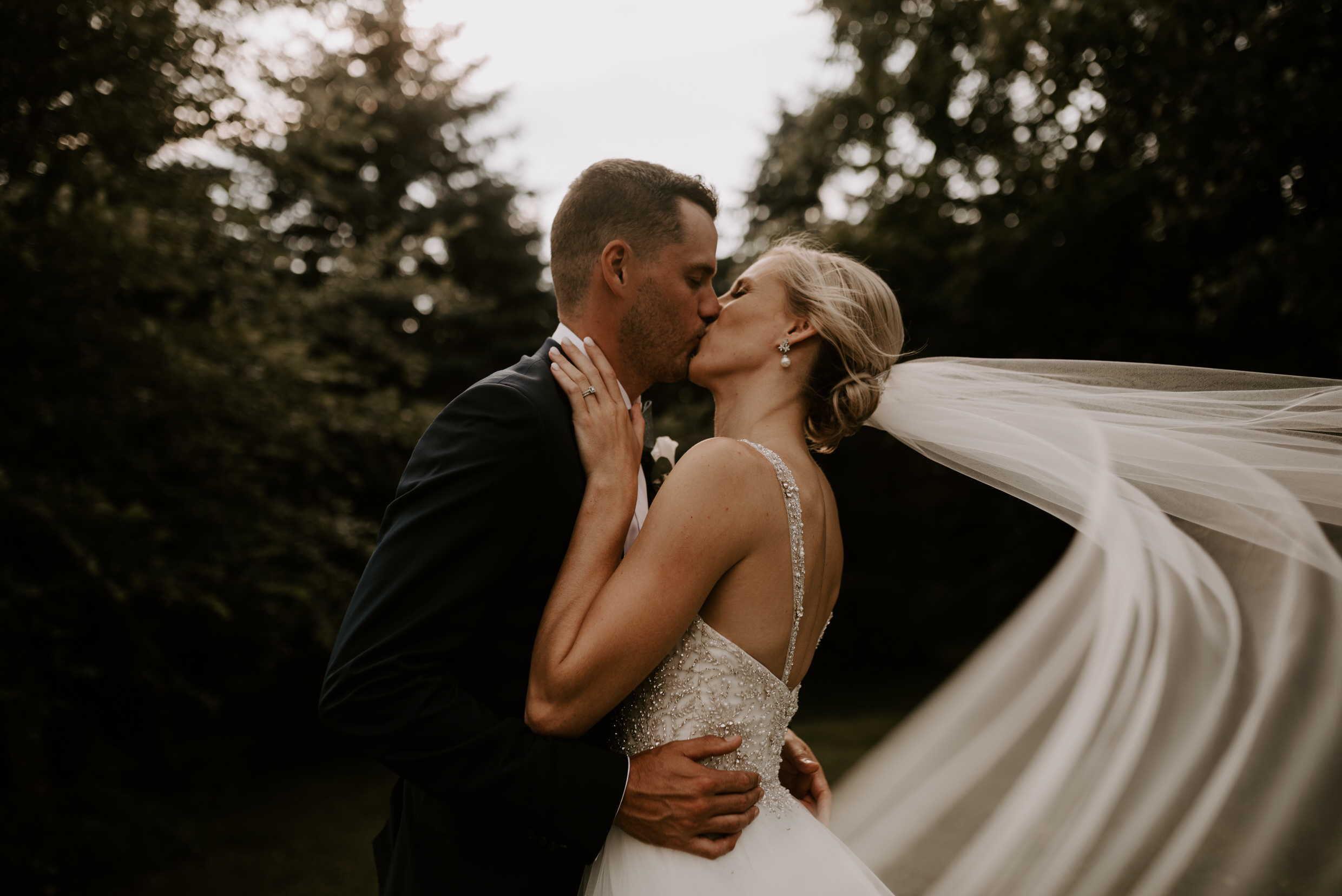 Belcroft Estates Wedding - bride and groom kissing veil