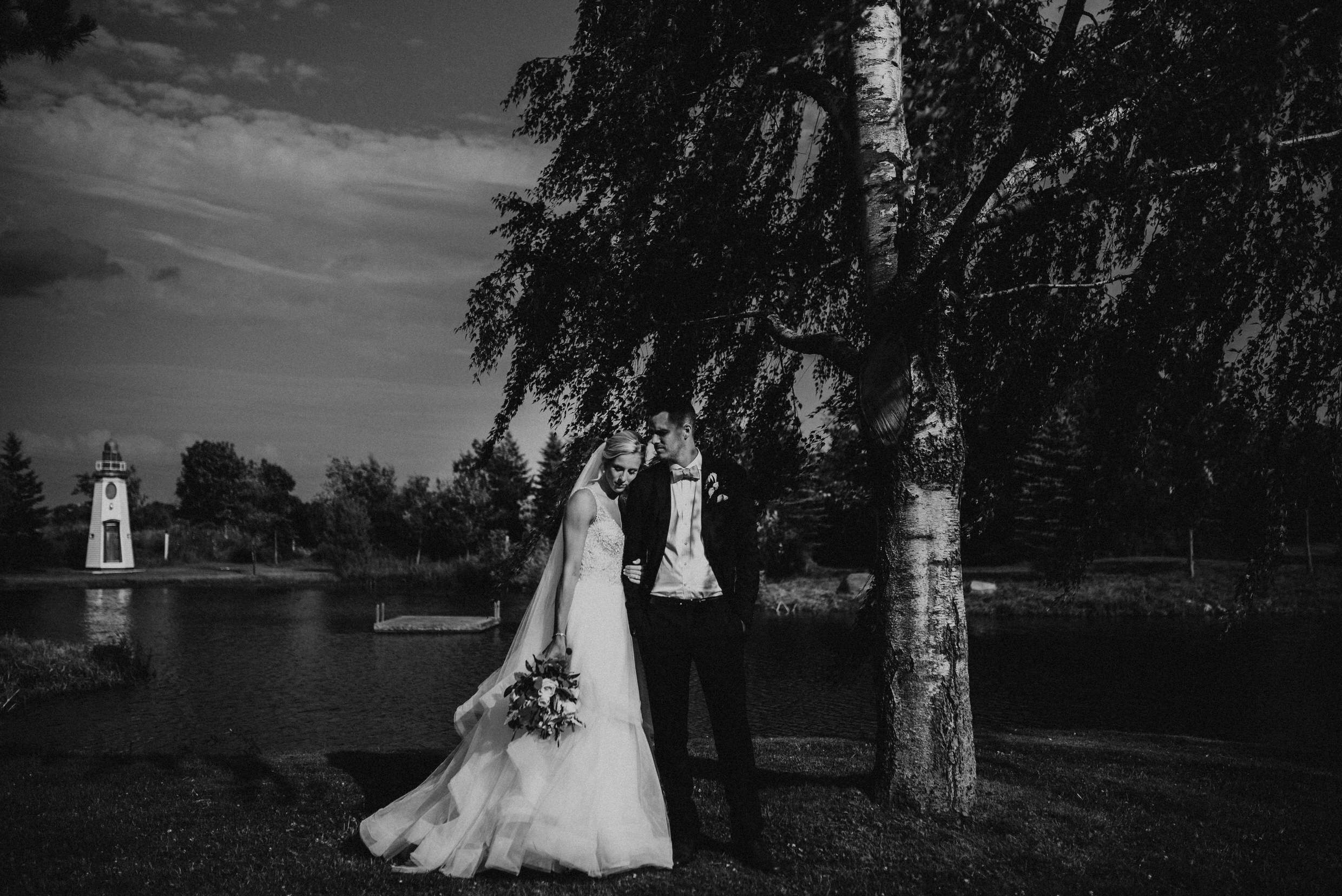 Belcroft Estates Wedding - bride and groom by the pond