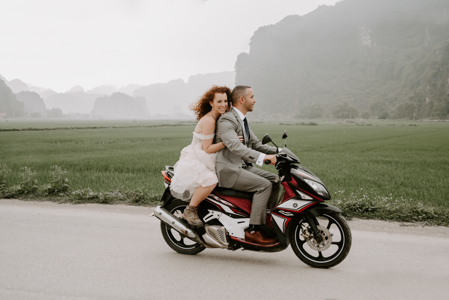 bride and groom ride motorbike in Vietnam