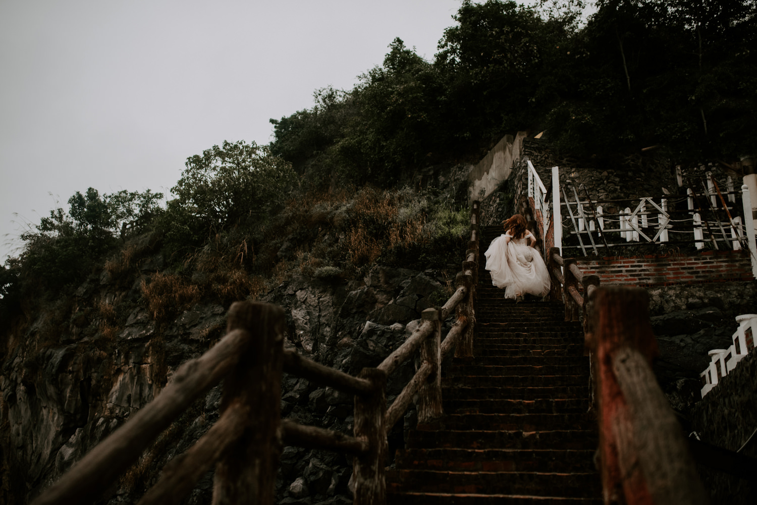 bride walking up stairs during elopement in vietnam